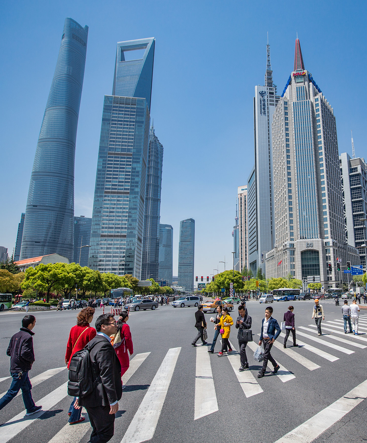 photo essay s consumers momentum kelley school of business people walking on the streets of shanghai among the city s tall buildings